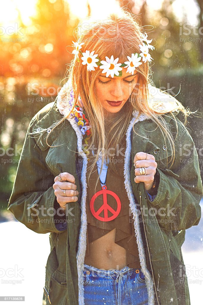 Girl hippie revolutionary 1970 style. Picture ruined simulation stock photo