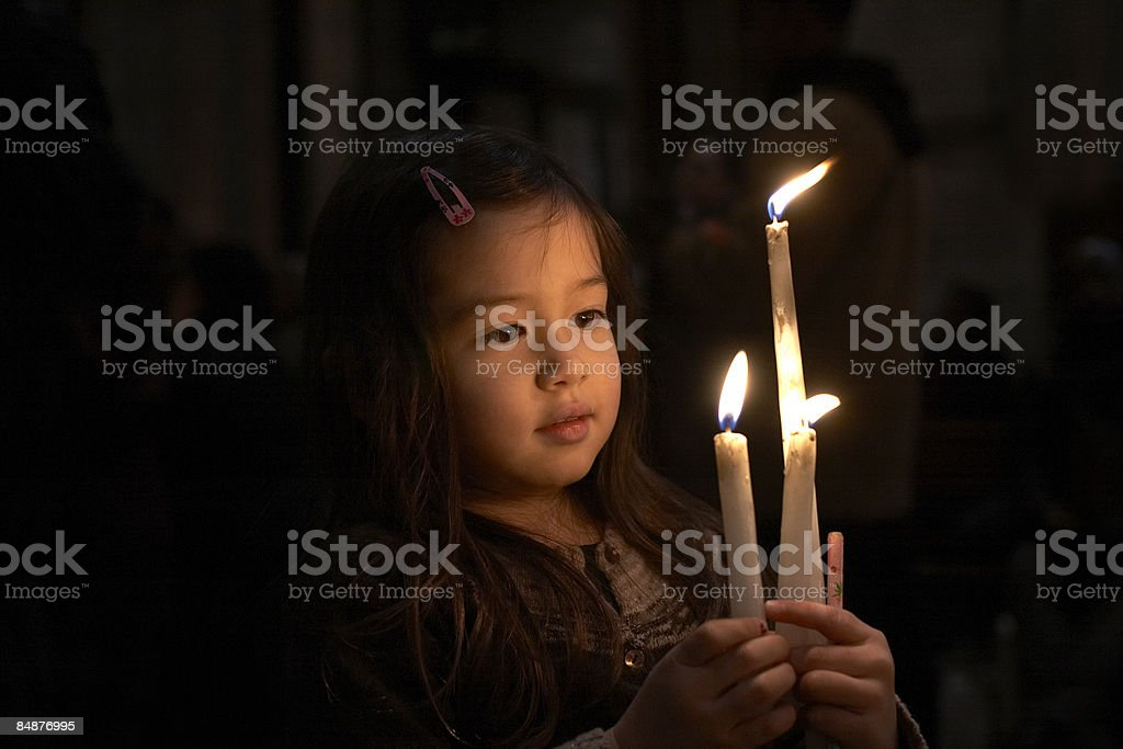 girl holding 3 candles royalty-free stock photo