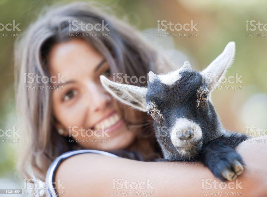 Girl holding a Baby Goat (XXXL) stock photo