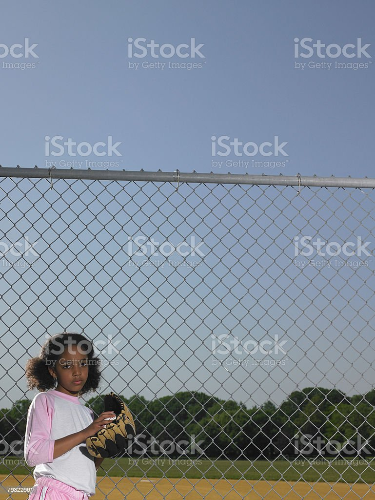 A girl holding a baseball and baseball glove royalty-free 스톡 사진