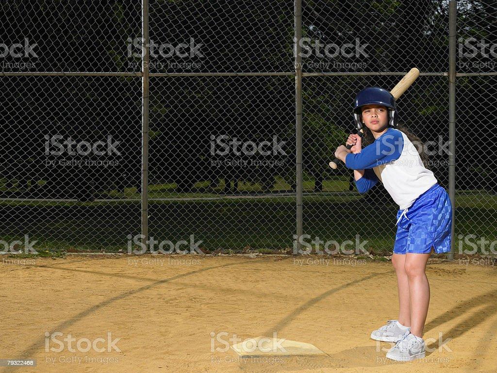 A girl holding a baseball bat 免版稅 stock photo