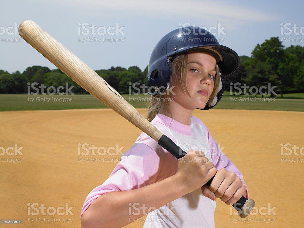 A girl holding a baseball bat royalty-free 스톡 사진