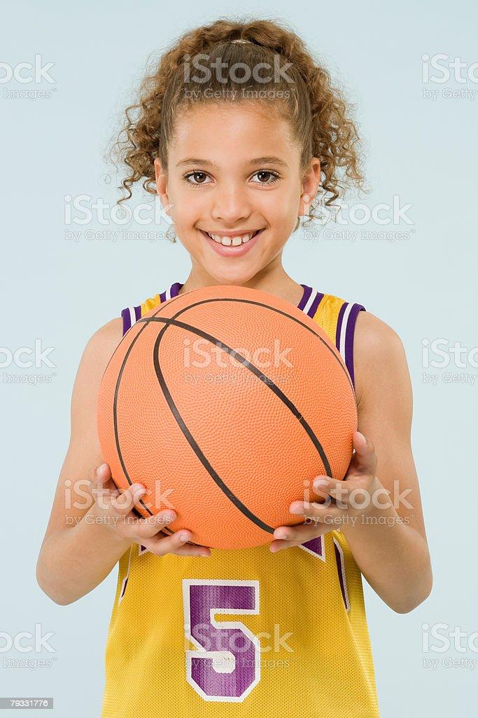 Girl holding a basketball 免版稅 stock photo