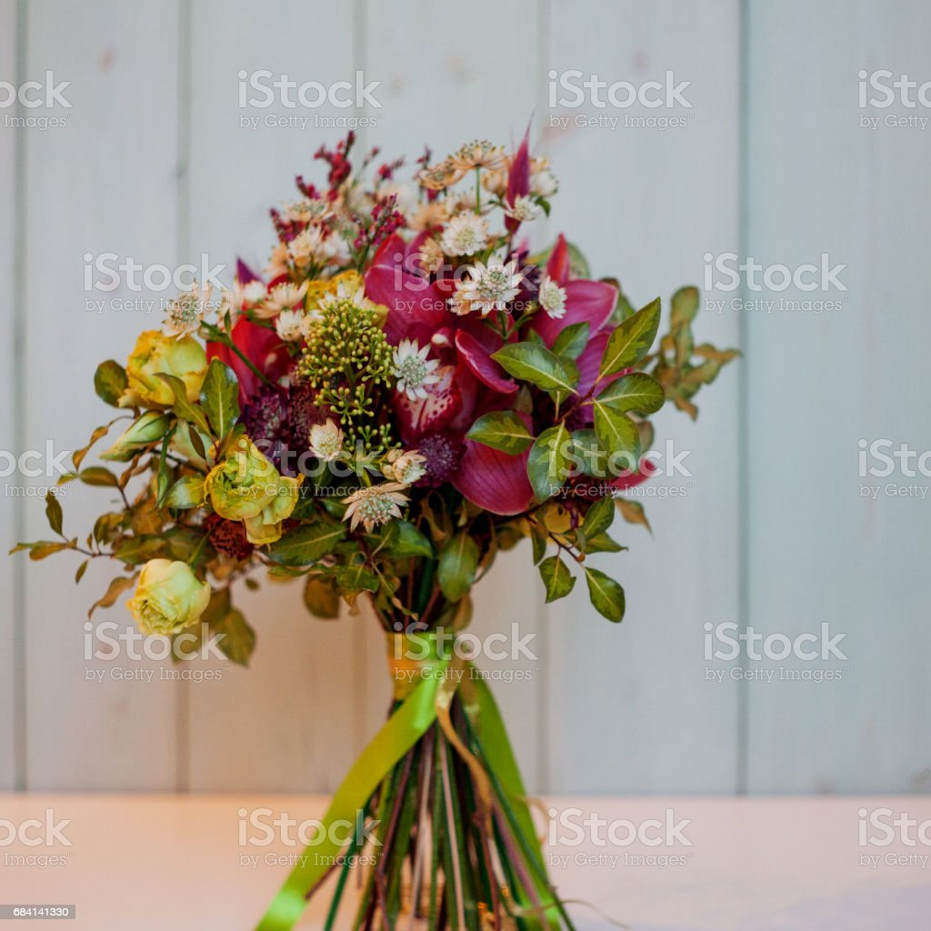 Girl holding a beautiful lush bouquet with lily, gift foto stock royalty-free