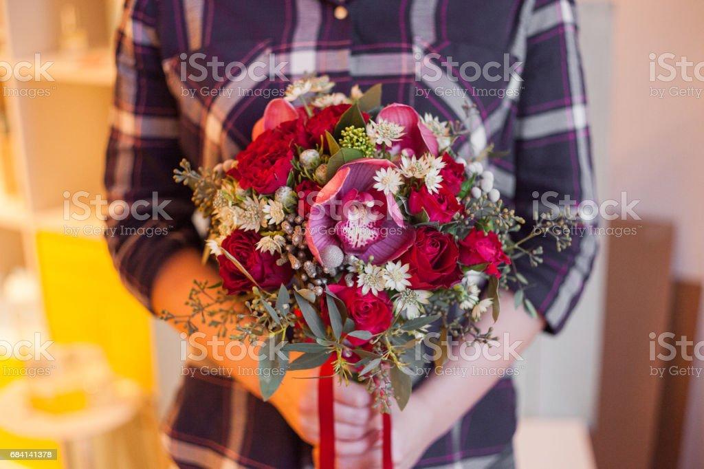 Girl holding a beautiful lush bouquet with lily, gift zbiór zdjęć royalty-free