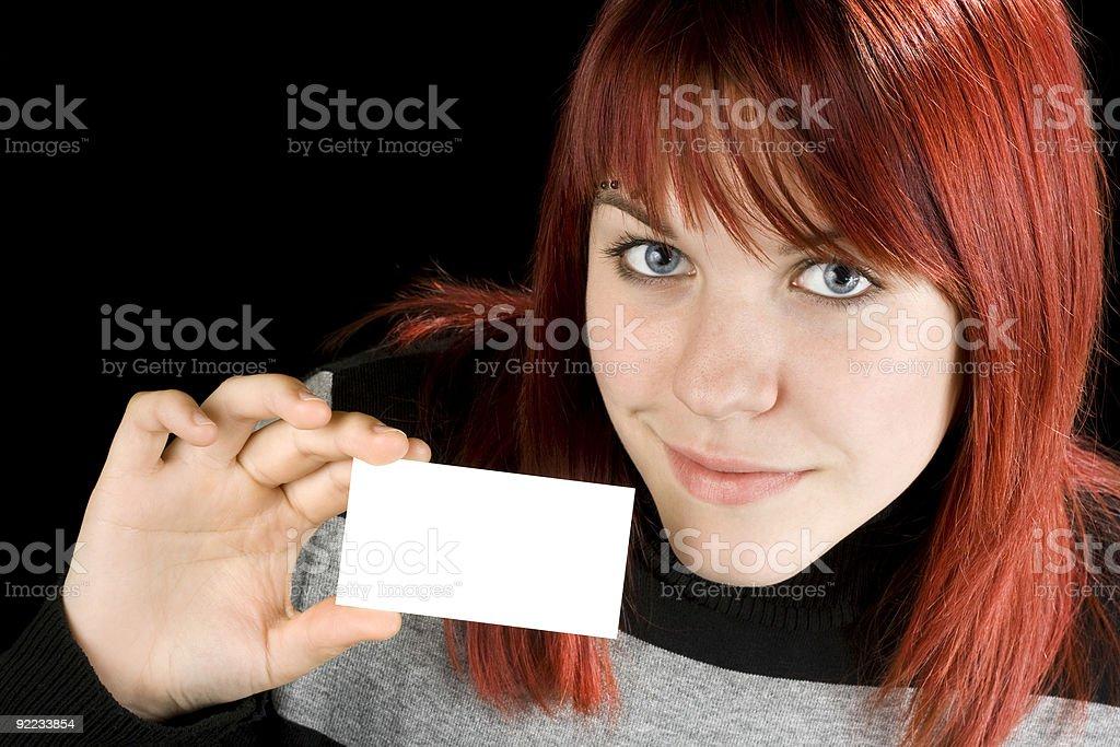 Girl holding a blank card stock photo