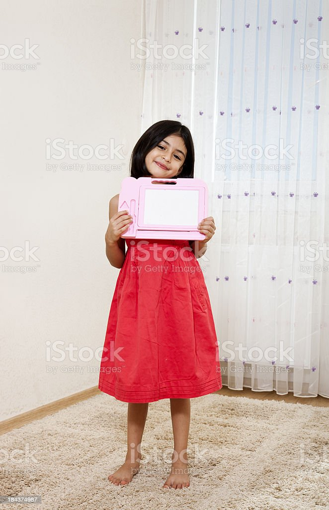 Girl Holding a Blank Chalkboard royalty-free stock photo