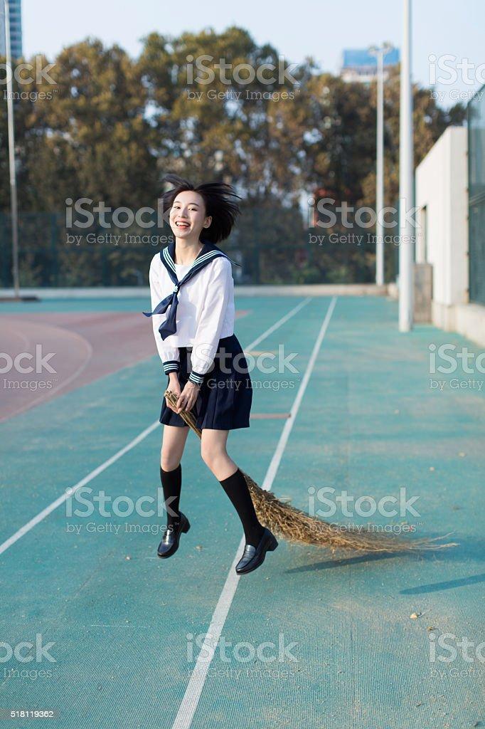 girl holding a broom stok fotoğrafı