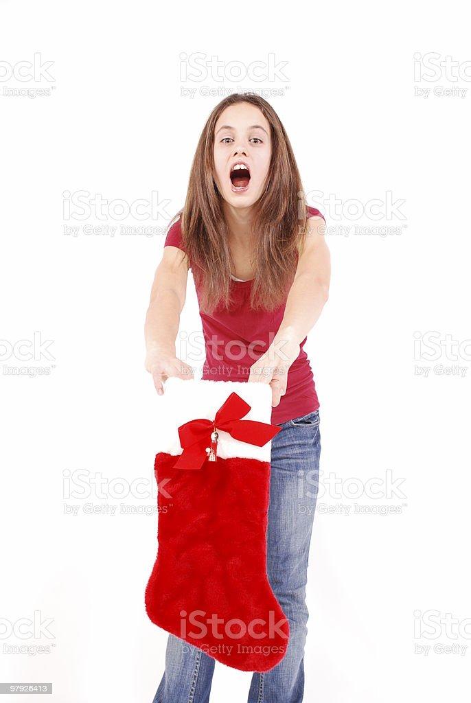 Girl holding a Christmas stocking royalty-free stock photo