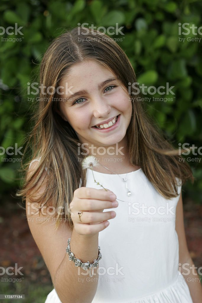 Girl holding a flower royalty-free stock photo