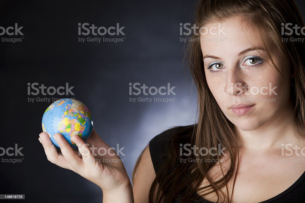 girl holding a globe royalty-free stock photo