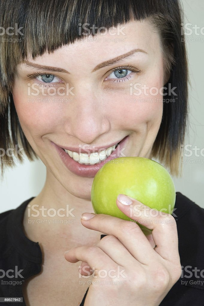 Girl holding a green apple royalty-free stock photo