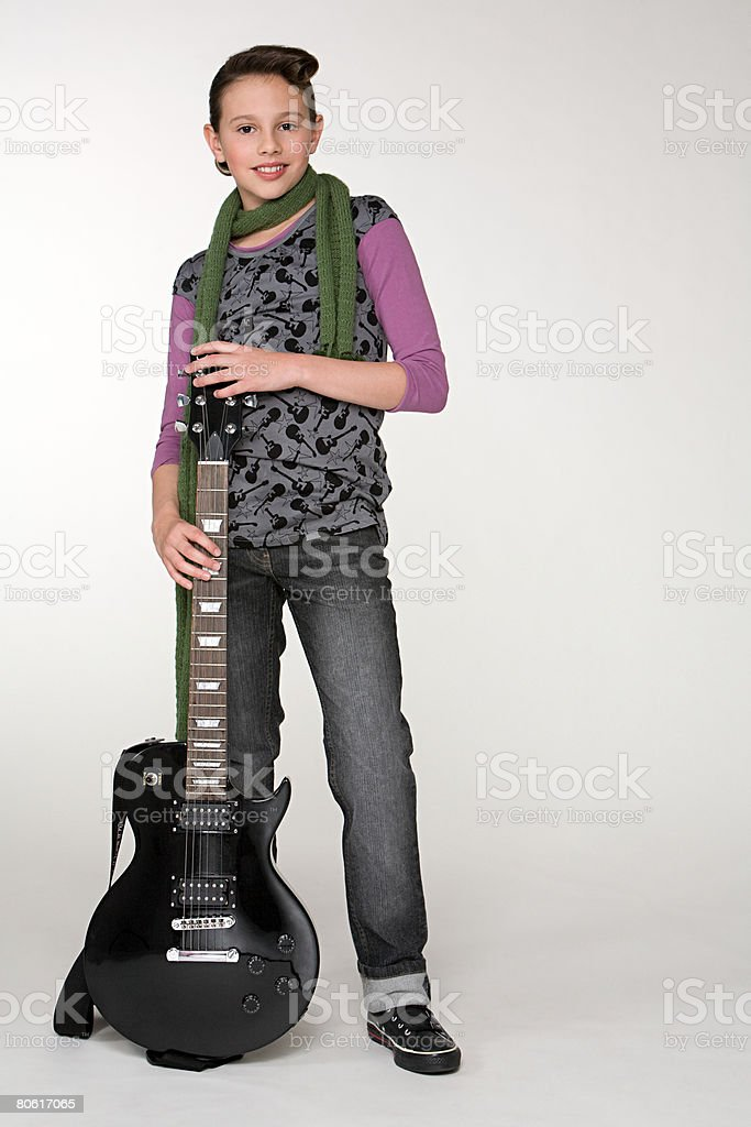 A girl holding a guitar foto de stock royalty-free