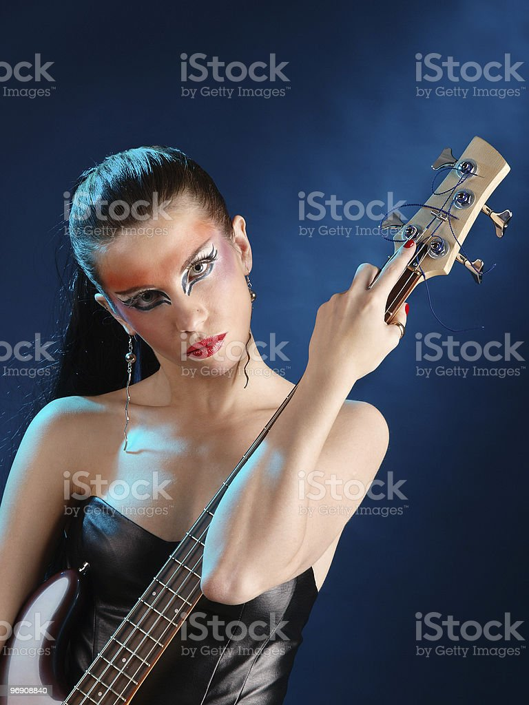 Girl holding a guitar royalty-free stock photo
