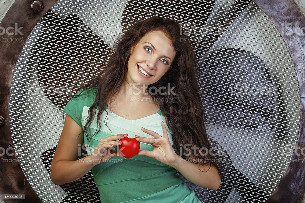 Girl holding a heart royalty-free stock photo