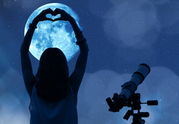 girl holding a heart - shape with telescope, moon and stars. my astronomy work. - romantic moon stock photos and pictures