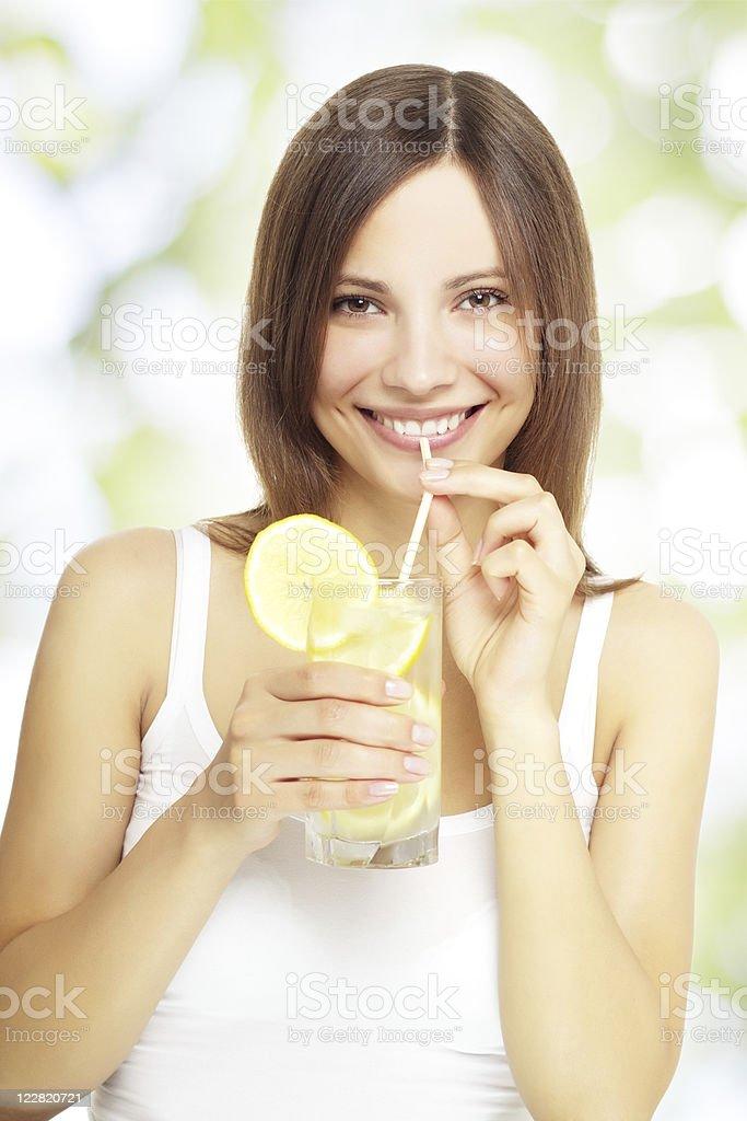 girl holding a lemonade royalty-free stock photo