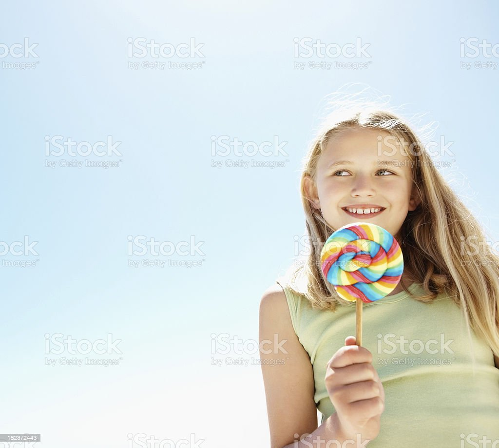 Girl holding a lollipop royalty-free stock photo