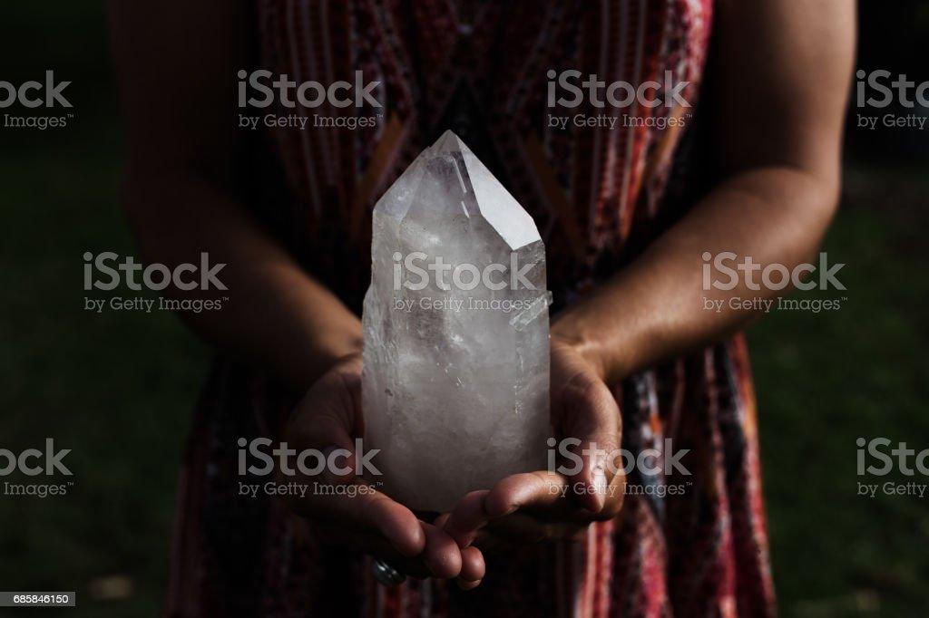 Girl Holding a Luminous Quartz Crystal stock photo