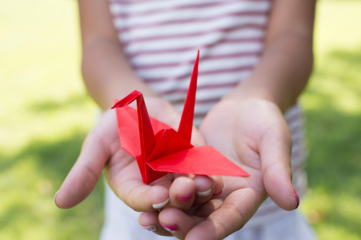 Girl holding a paper crane