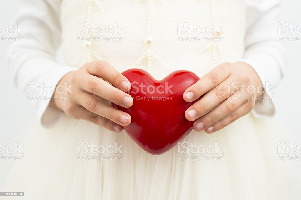 Girl holding a red heart royalty-free stock photo