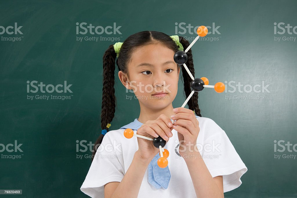 A girl holding a science model royalty-free 스톡 사진