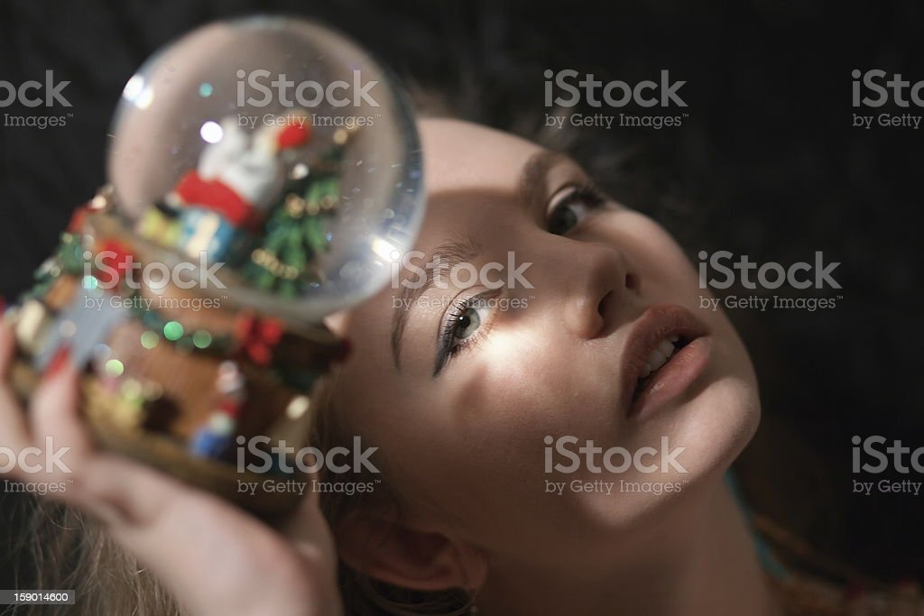 Girl holding a snow globe. royalty-free stock photo