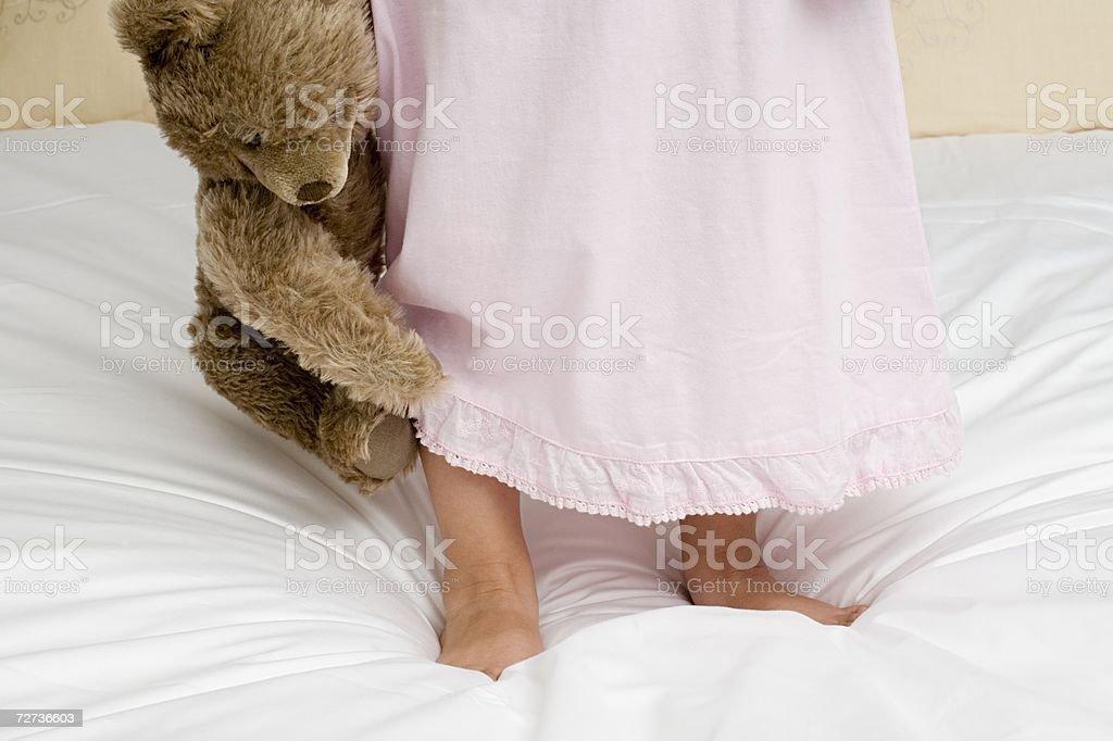 Girl holding a teddy bear royalty-free stock photo