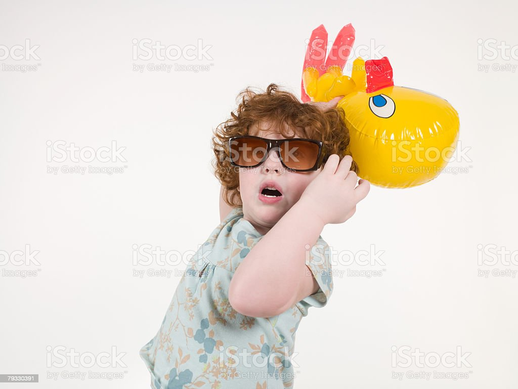 A girl holding a toy 免版稅 stock photo