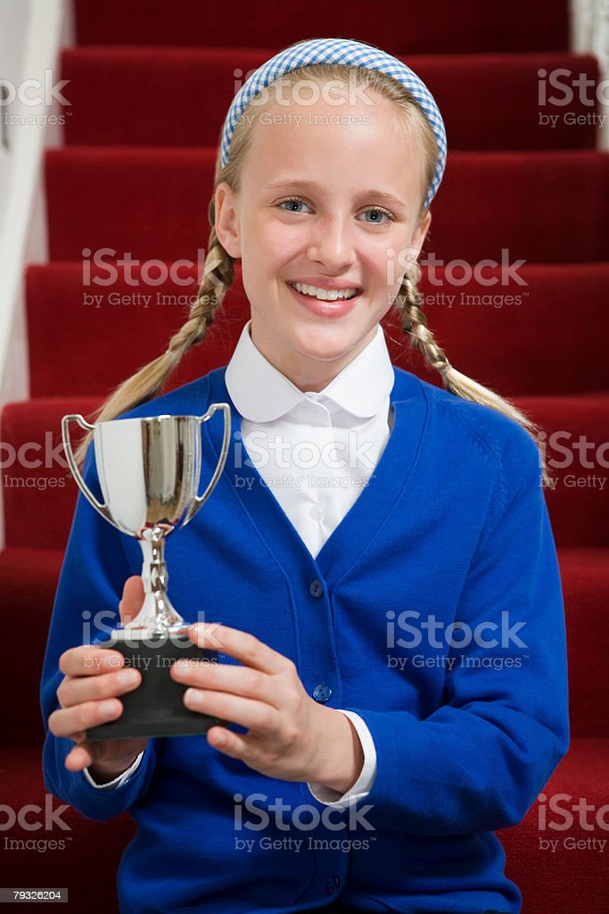 Girl holding a trophy royalty-free 스톡 사진