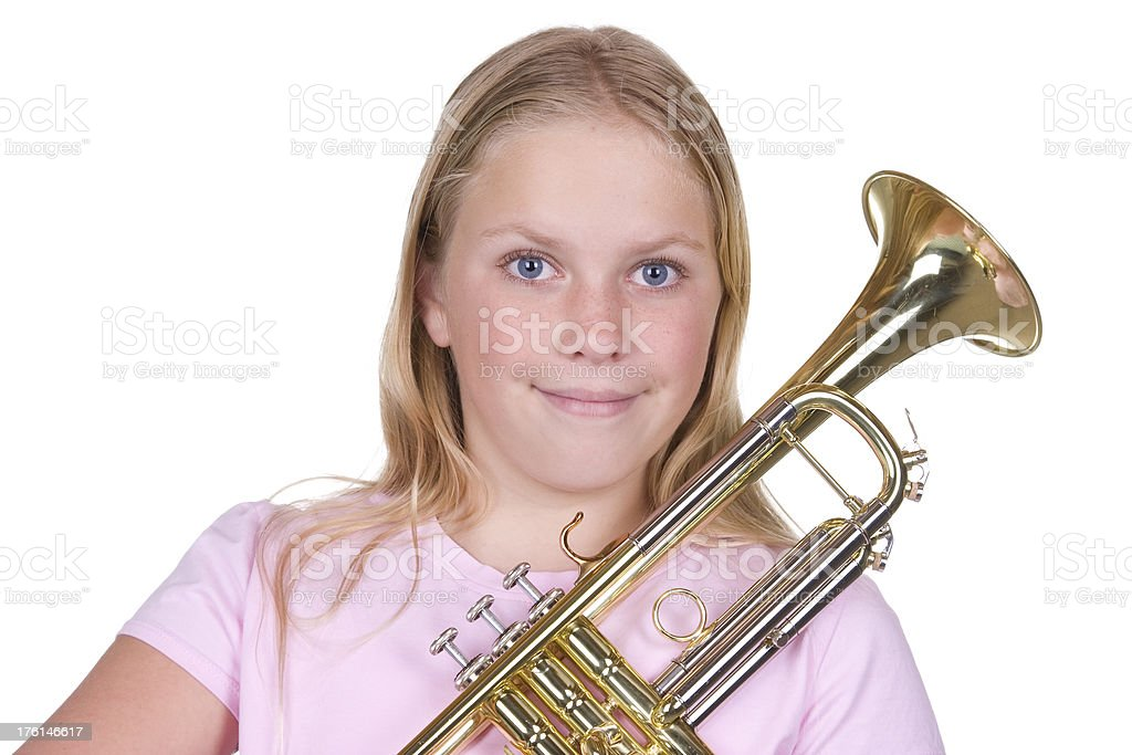 Girl holding a trumpet. stock photo