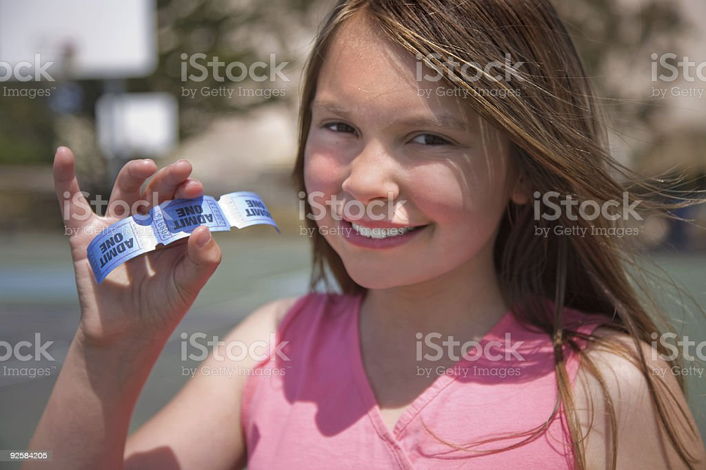 Girl holding admission tickets stock photo