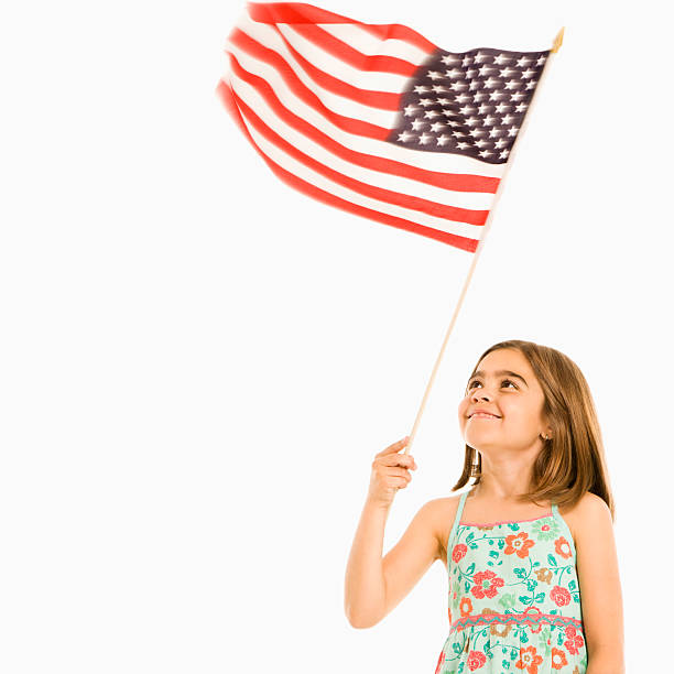 Girl holding American flag. stock photo