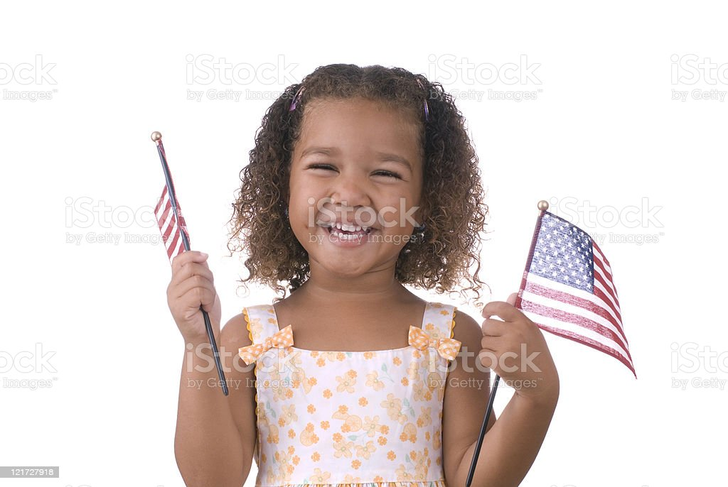 Girl holding American flags royalty-free stock photo