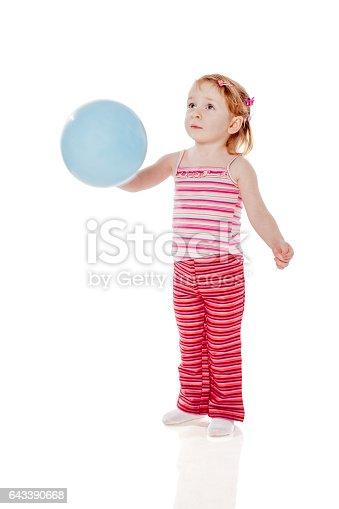 istock Girl Holding Balloon 643390668