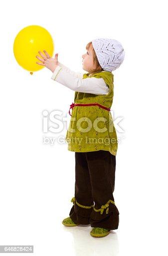 istock Girl Holding Balloon 646828424
