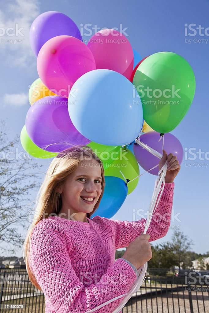 Girl holding balloons royalty-free stock photo