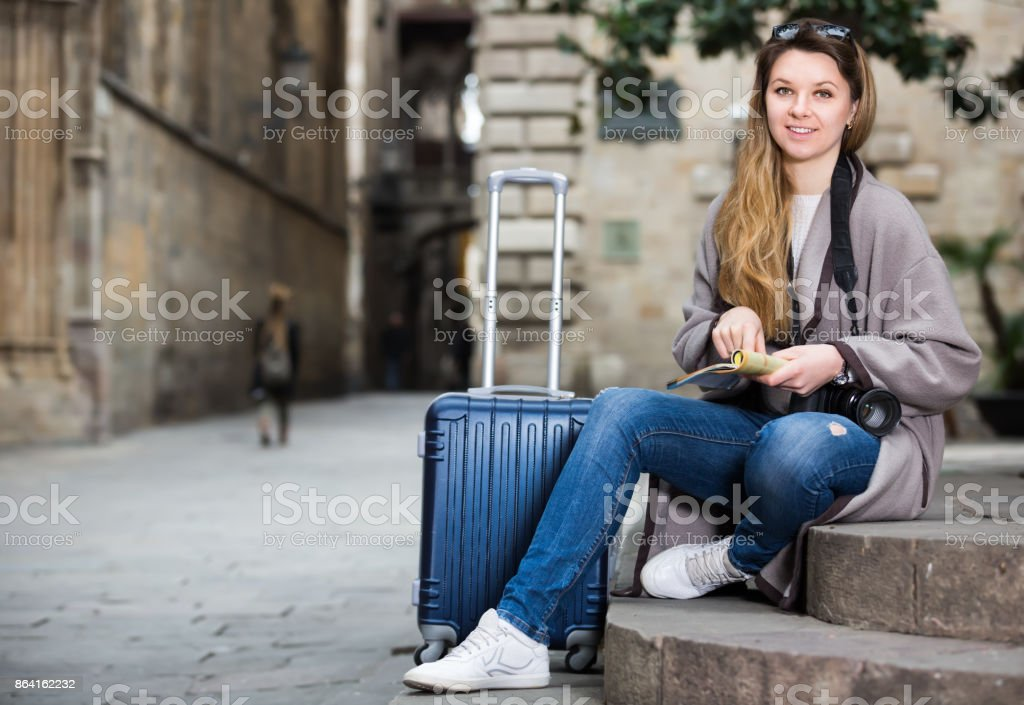 Girl holding brochure royalty-free stock photo