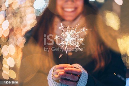 Happy woman making a Christmas wish outside