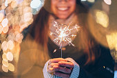 istock Girl holding burning sparkler during Christmas 1190641846