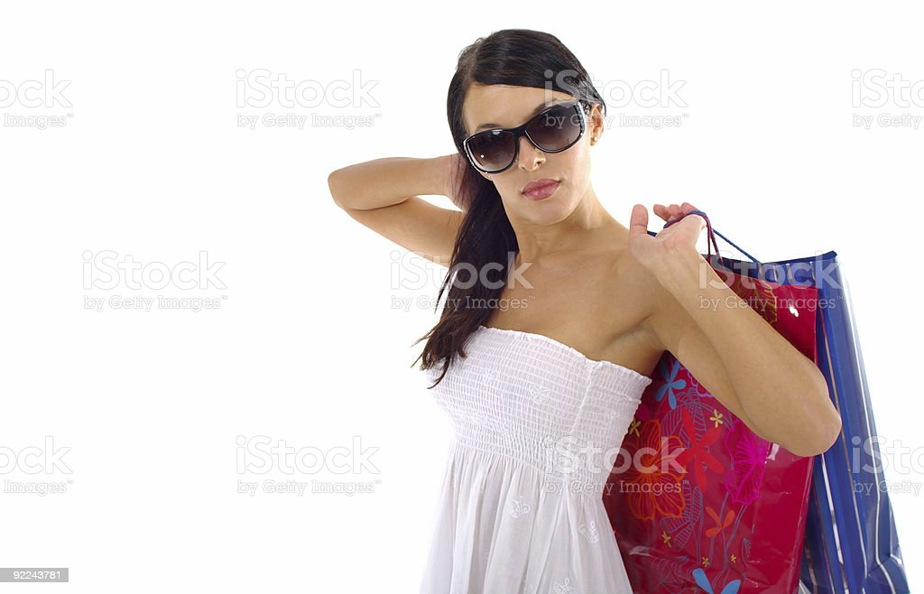 Girl holding colorful shopping bags .White background royalty-free stock photo