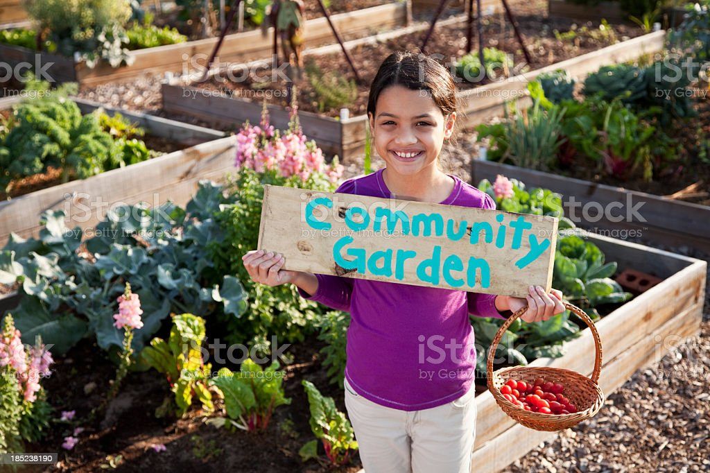 Girl holding community garden sign royalty-free stock photo