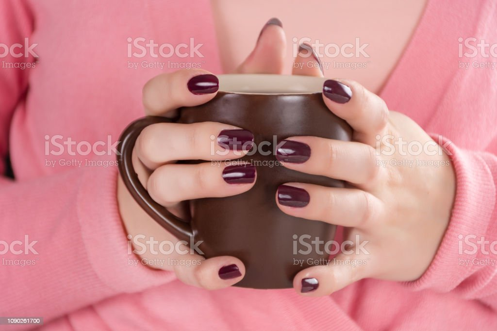 Girl Holding Cup Of Tea In Hand With Red Wine Color Manicure Nails Polish Stock Photo Download Image Now