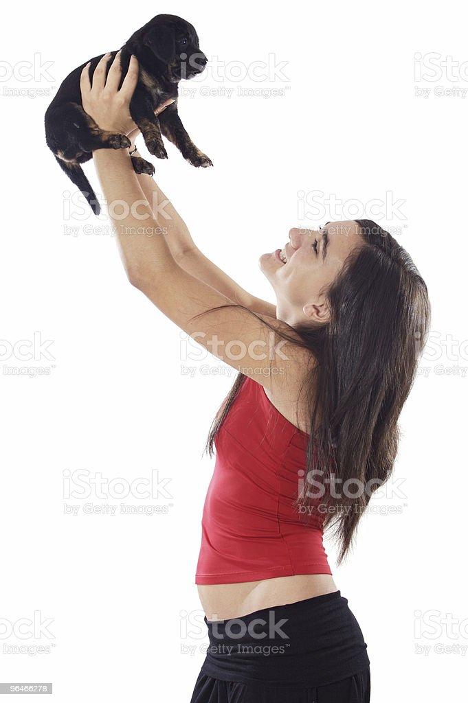 Girl holding dog royalty-free stock photo