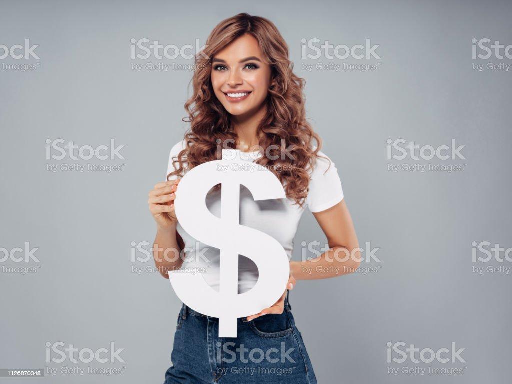 Girl holding dollar symbol stock photo