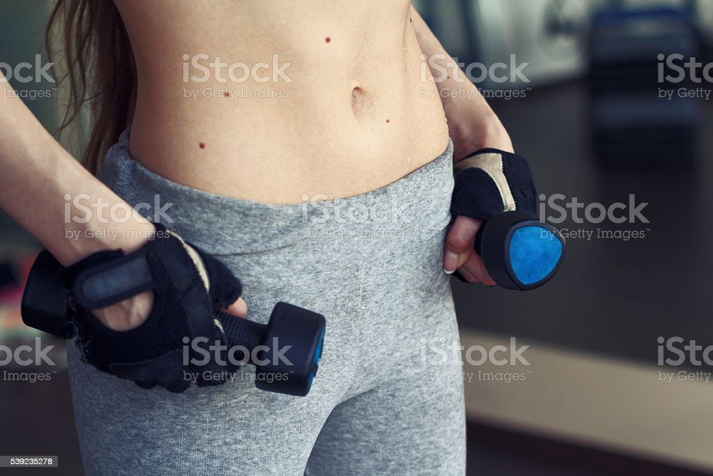 Girl holding dumbbells royalty-free stock photo