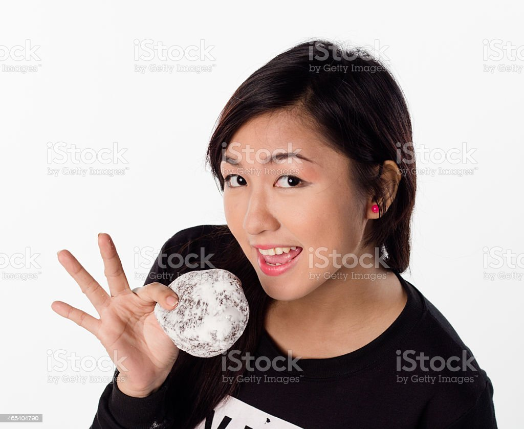 girl holding, eating a donut stock photo