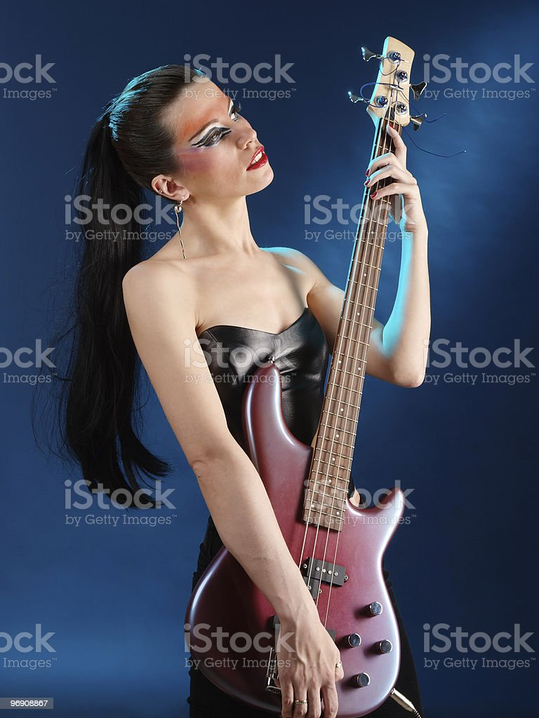 Girl holding electric guitar royalty-free stock photo