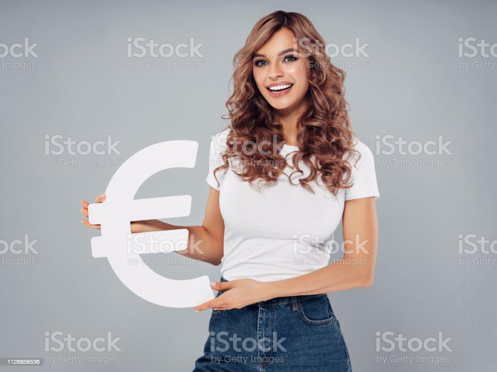 Girl holding euro symbol stock photo