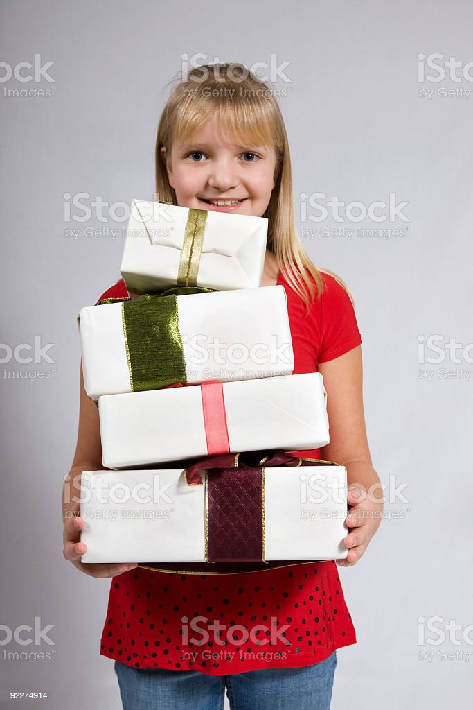 Girl holding gifts stock photo